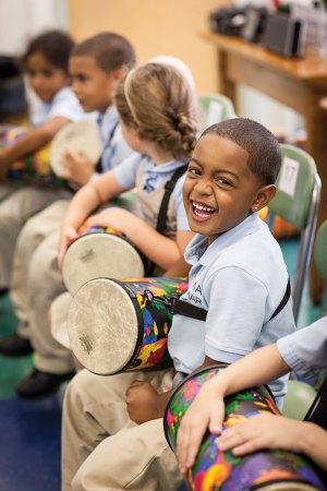 Boy playing music in school