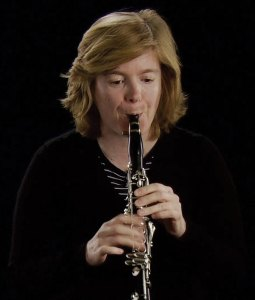 Woman playing an oboe