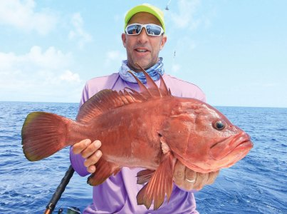 Man holding a large red fish