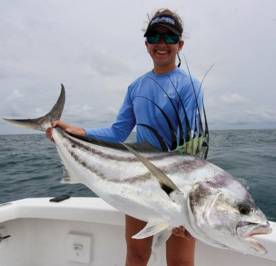 Woman holding a roosterfish