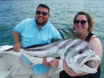 Couple with roosterfish
