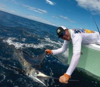 Man releasing marlin