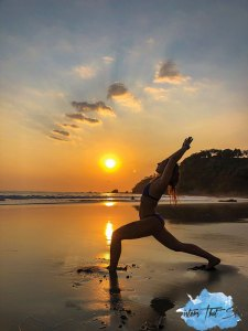 yoga on the beach at sunset