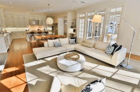 Bright kitchen, dining, living room and patio