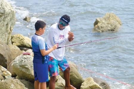 Instructor a boy fishing
