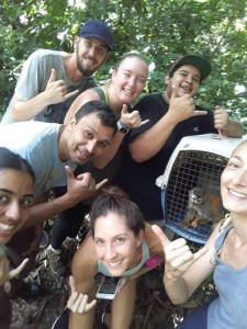 Volunteers with a titi monkey