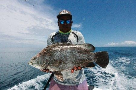 manho lding large fish