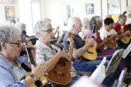 Seniors learning to play ukuleles
