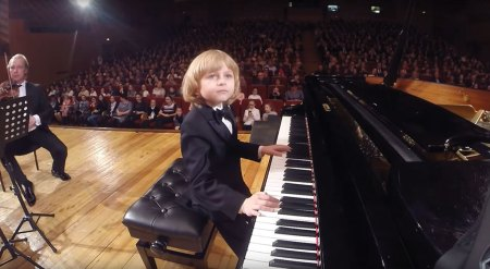 Boy playing piano concert
