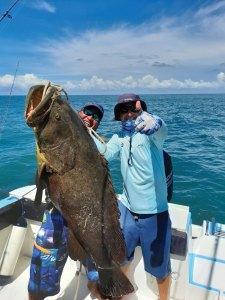 2 men holding big fish