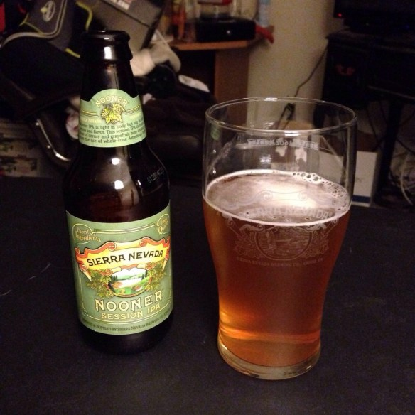 A bottle of Sierra Nevada Nooner Session IPA is on display next to a glass of the ale.