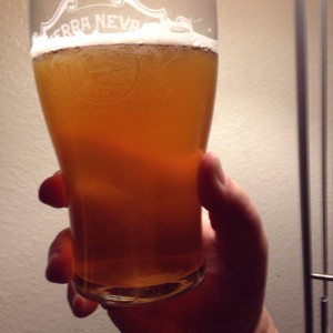 Sierra Nevada Nooner Session IPA looks amber and coppery when it is held to the light.