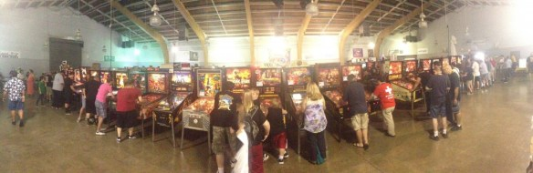 A panorama of one of the rows of playable pinball machines at the 2014 Pin-a-Go-Go in Dixon, California.