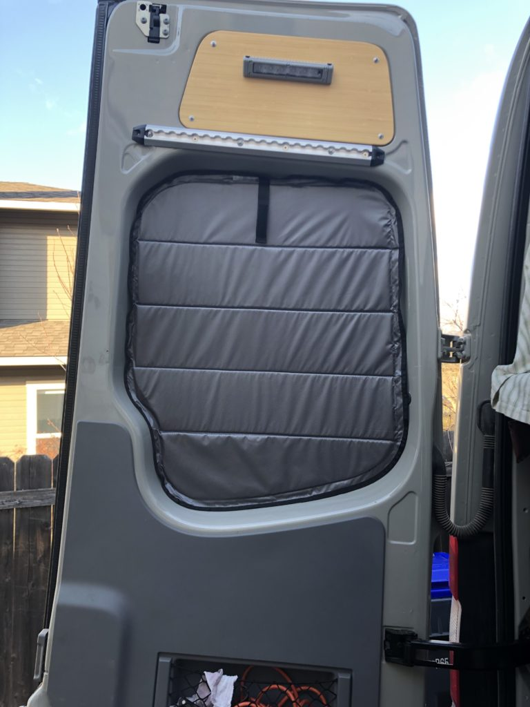 Sprinter van window shade in place on rear door