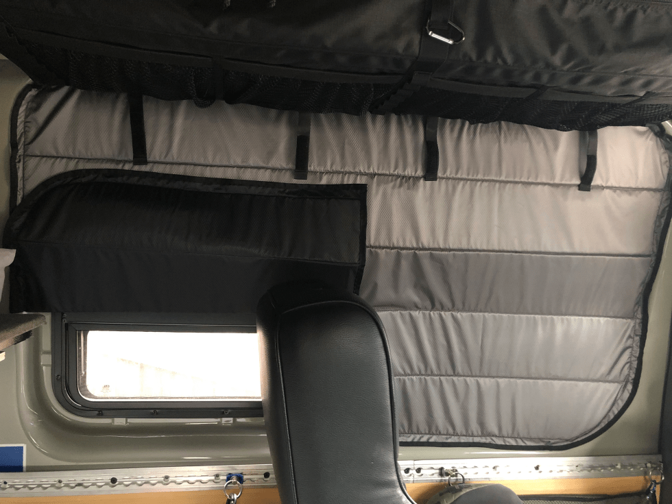Crew window cover, half vent open