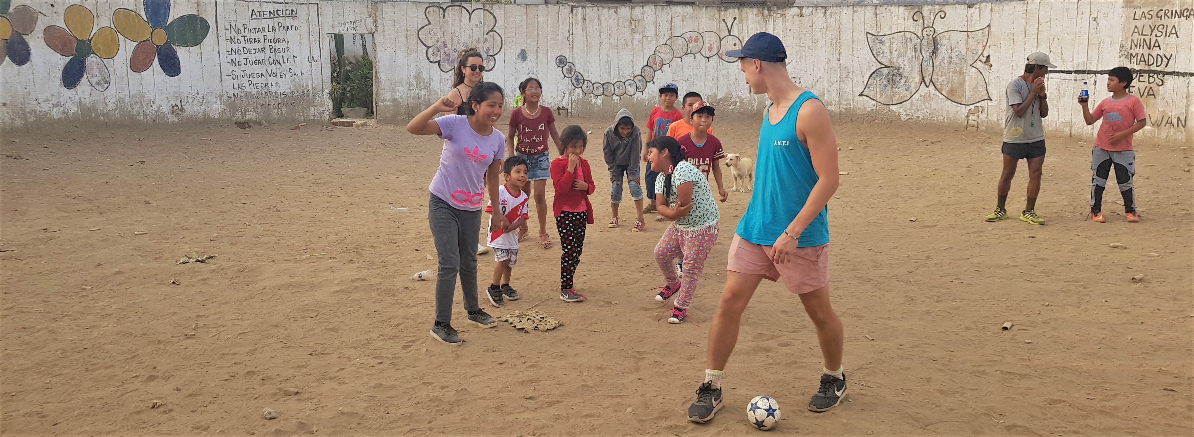 Alex volunteers with the local community, giving the children their right to play!