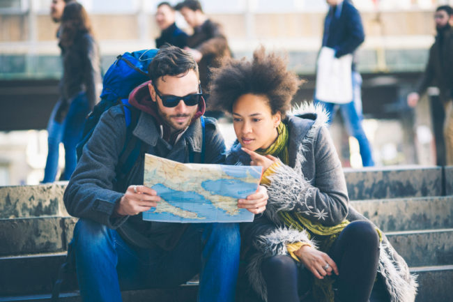 Couple Traveling Looking at a Map
