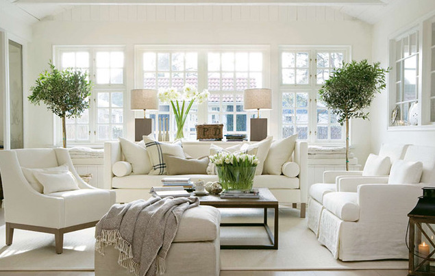 Neutral living room with green accent pieces