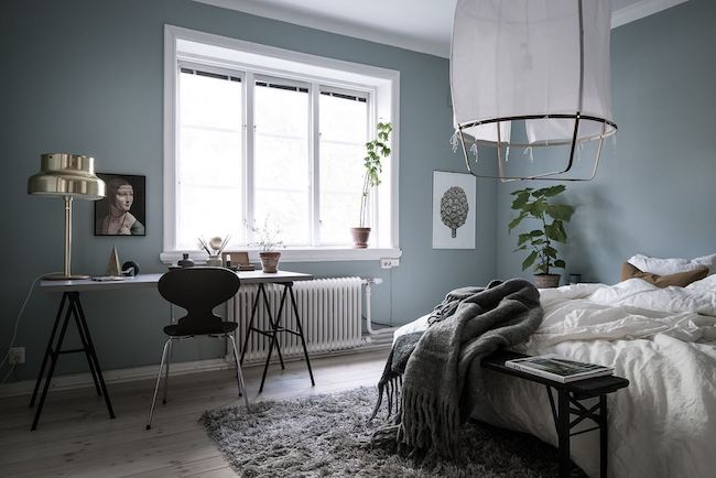 Light blue colored bedroom.