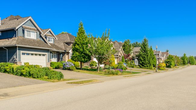 Lovely suburban neighborhood with green lawns and trees.