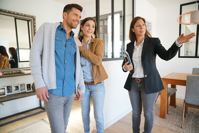 Realtor showing couple a new home.