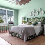 HGTV Dream Home 2020 - Guest Bedroom with light green walls, palm leaf headboard, open windows