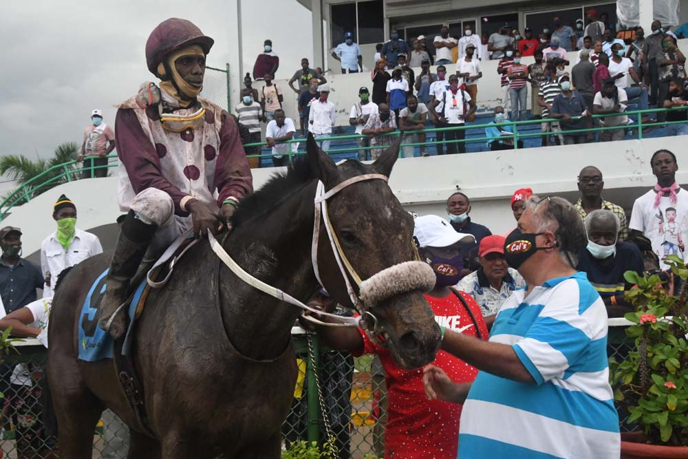 Trainer Wayne DaCosta (right) in the winners' enclosure with his 2020 Derby winner King Arthur. The jockey is Phillip Parchment.