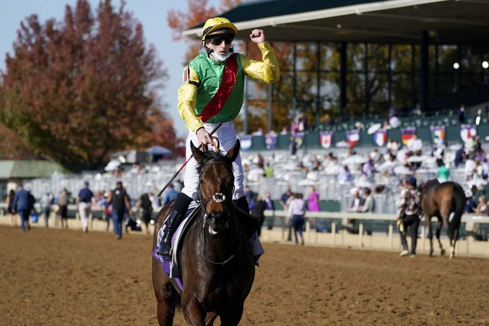 Pierre-Charles Boudot, celebrates atop Audarya after winning the Breeders' Cup Filly & Mare Turf horse race at Keeneland Race Course, in Lexington, Ky., Saturday, Nov. 7, 2020.