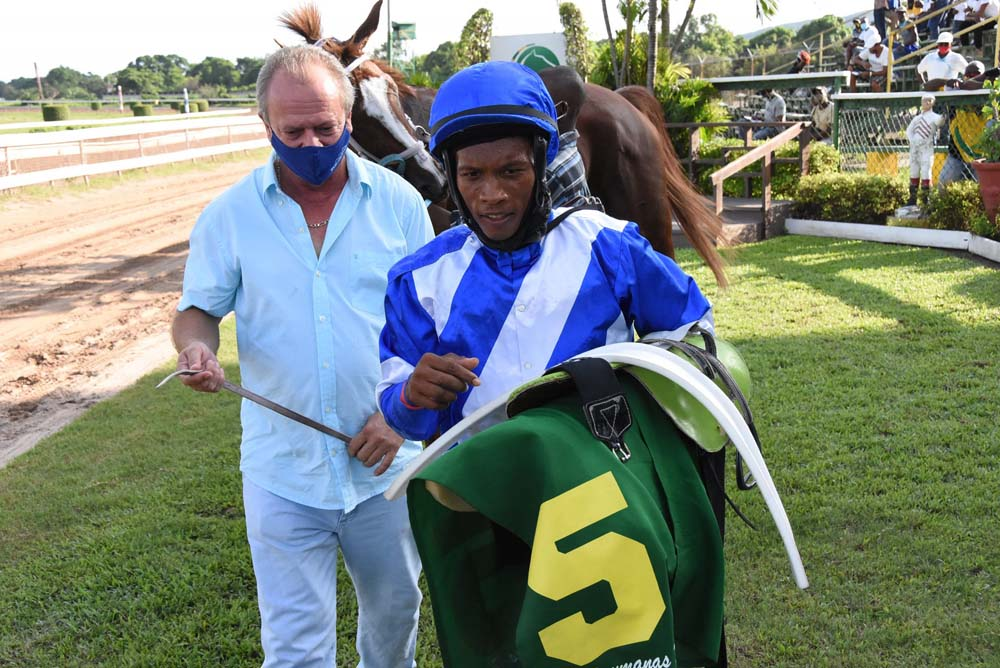 Trainer Gary Subratie (left) and jockey Anthony Thomas