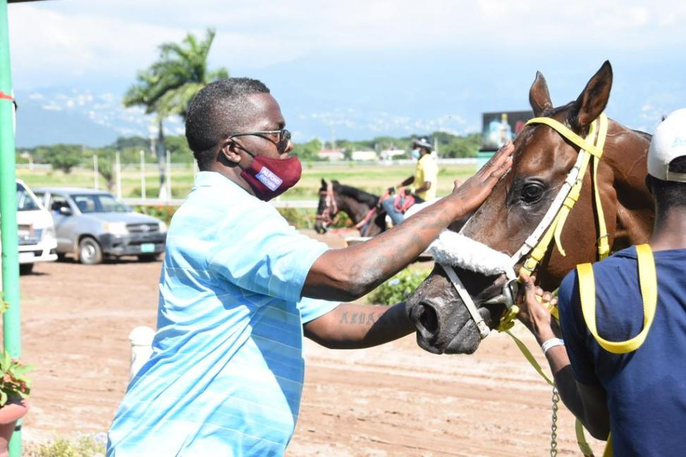 Trainer Alford Brown greets D's Choice.