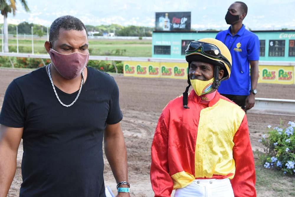 Trainer Ryan Darby (left) and jockey Omar Walker.