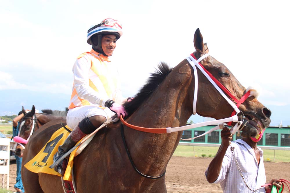 Jockey Abigail Able flashes her winning smile as she guides Top Eagle into the winners' circle. (Photo: Kimberly Bartlett)
