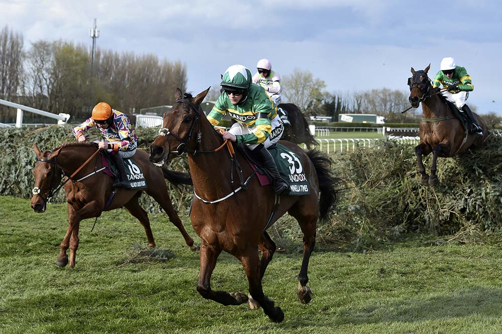 Rachael Blackmore riding Minella Times clears the last fence to win the Randox Grand National Handicap Chase on the third day of the Grand National Horse Racing meeting at Aintree racecourse, near Liverpool, England, Saturday April 10, 2021.