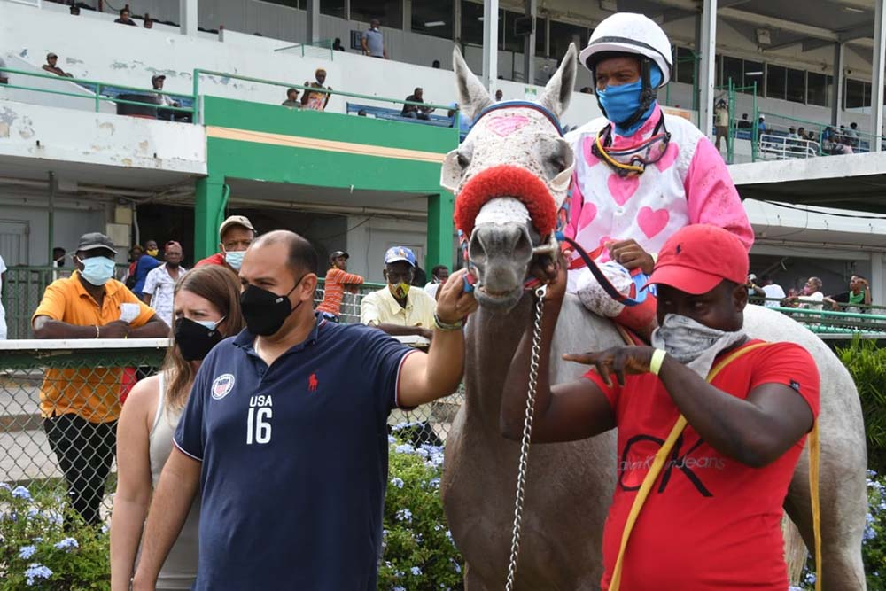 Jason DaCosta (second left) celebrates his first winner Elitist. The Jockey is Anthony Thomas and the groom Shaquille Skeen)