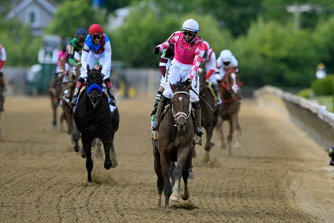 Flavien Prat aboard  Rombauer, center, reacts after winning the Preakness Stakes