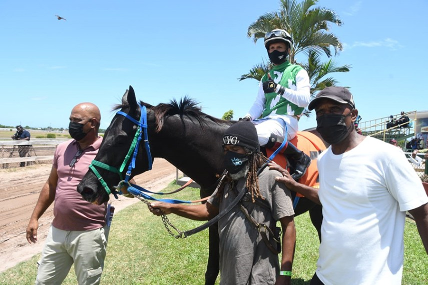 Code of Honor in the winners' enclosure with Dick Cardenas in the saddle. Trainer Michael Marlowe is at right.