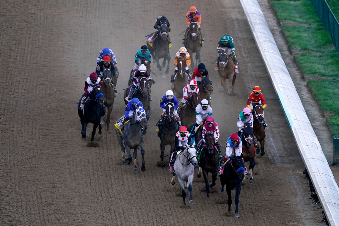 The field of horses head out of the gate as they compete in the 147th running of the Kentucky Derby at Churchill Downs, Saturday, May 1, 2021, in Louisville, Ky. (AP Photo/Charlie Riedel)