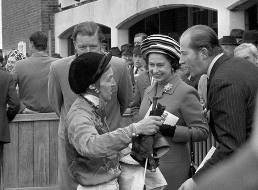 Joe Mercer (left) having a chat with Queen Elizabeth 11.
