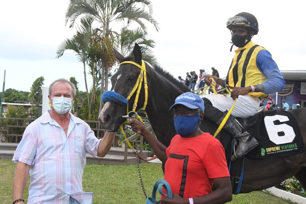 Trainer Gary Subratie (left) with Sencity. The jockey is Tevin Foster.