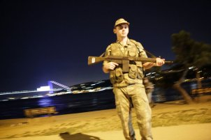 """A Turkish soldier stands on guard on the side of the road on July 15, 2016 in Istanbul, during a security shutdown of the Bosphorus Bridge. The Turkish military on July 15 said that it had assumed power over Turkey, in what the prime minister has termed an illegal act. """"The power in the country has been seized in its entirety,"""" said a military statement read on NTV television, without giving further details. The military's website was not immediately accessible. / AFP / Yasin AKGUL (Photo credit should read YASIN AKGUL/AFP/Getty Images)"""
