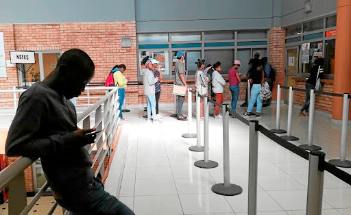 Students queue at a NSFAS office in Johannesburg