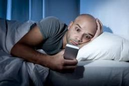 holding a phone in bed