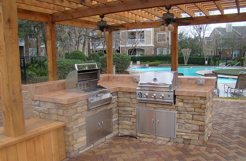 Quiet corner outdoor kitchens design ideas and tips for Outdoor stone kitchen designs