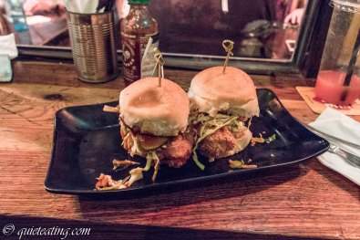 Crispy chicken, tempura battered dark meat chicken, asian slaw, house pickles, sesame mayo and BBQ sauce