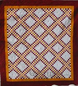 Jennie Beth's finished Irish Chain quilt, custom quilting by Angela Huffman