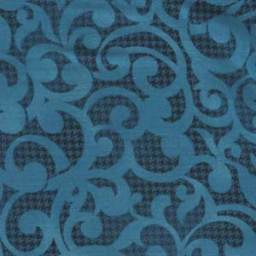 "Filigree in Turquoise from Studio E. The print has a turquoise filigree scroll over a much darker blue textured background. 108"" wide back fabric. Available at QuiltedJoy.com"