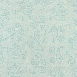 A marbled pale blue background with a swirled vine print. Available at QuiltedJoy.com