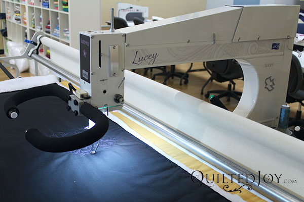 The APQS Lucey quilting machine - QuiltedJoy.com