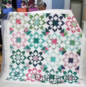 Colleen made this quilt with Thimble Blossom's Fireworks quilt pattern and Moda's Color Me Happy fabric collection