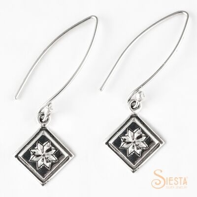 Lemoyne Star sterling silver earrings on long wire from Siesta Silver Jewelry. Available at QuiltedJoy.com